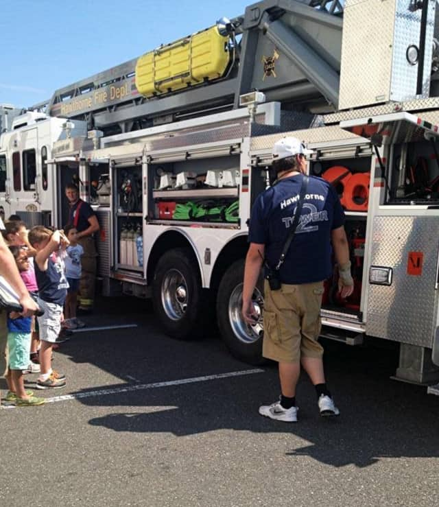In addition to features like live entertainments and food, there will be a display of fire trucks at Saturday's event.