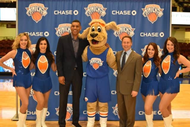 County Executive Rob Astorino and Westchester Knicks GM Allan Houston flank the Westchester Knicks' new mascot, Hudson, on Friday.
