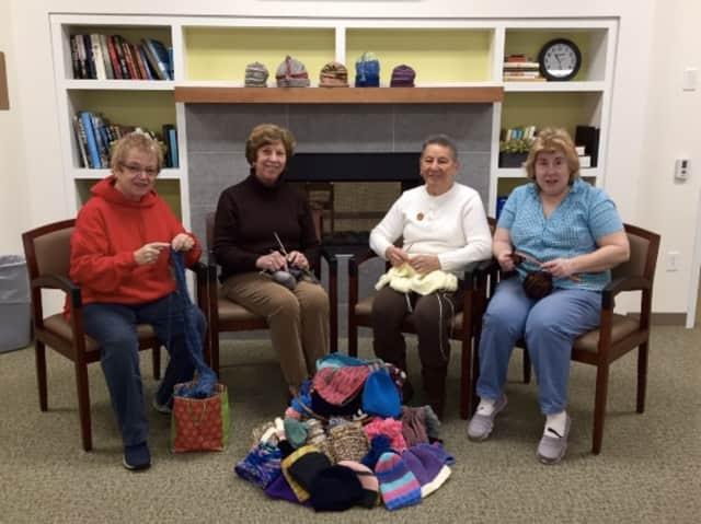 Cathy Oberle, Norma Gerwig, Elsie Ferrara, Deborah Couzzo of Darien's Community Knitting and Crochet Group. Not shown: Chris Cronin, NancyJo Rambush, Fran DeAngelis, and Emily Canau