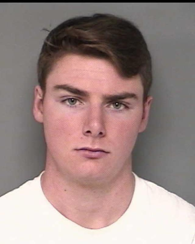 David Kuhn of Sherman was held on $500,000 bond in connection with an arson involving three cars at the University of Connecticut in Storrs.