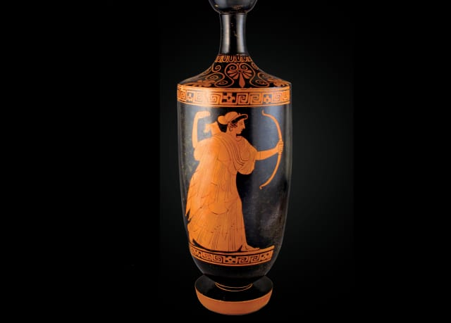 Lekythos, ca. 460–450 B.C. Attributed to the Carlsruhe Painter. Artemis with bow and quiver (detail). Terracotta; red-figure. Diameter: 4 3/8 × 2 5/16 × 3 1/8 in. (11 × 5.9 × 7.9 cm); Height: 12 3/4 in. (32.4 cm). Rogers Fund, 1941. Accession Number: 41.162.140. Courtesy The Metropolitan Museum of Art.