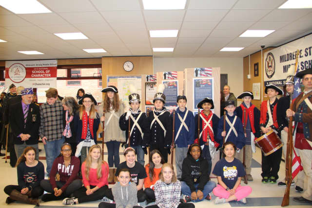 Mildred E. Strang Middle School honored Purple Heart recipient Eugene Lang.
