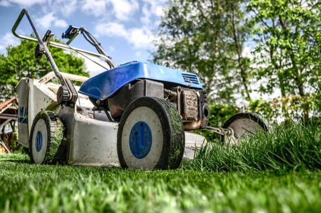 A man using an industrial lawn mower in Hunterdon County broke his leg after the machine slid down a hill, tipped over and trapped him Wednesday morning, state police said.