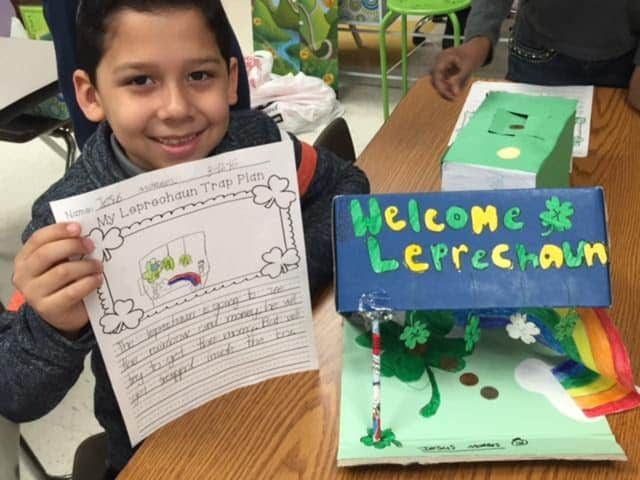 "A Columbus Elementary School student shows off his ""leprechaun trap."""