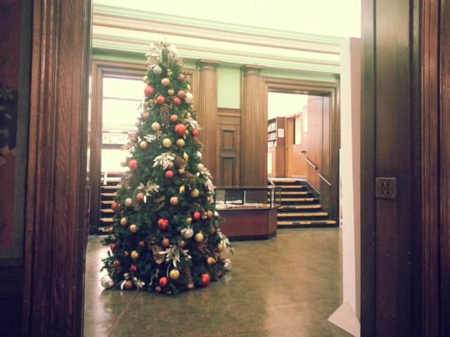 The holiday tree is up in the Mount Vernon Library's rotunda... but lights are missing. The tree lighting and festivities take place Monday, Dec 7.