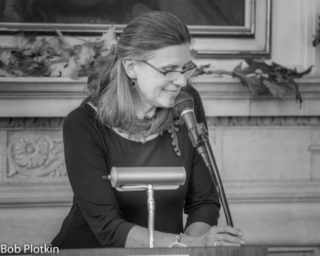 Lisa Olsson reads one of her works at November's poetry reading at the Warner Library in Tarrytown.