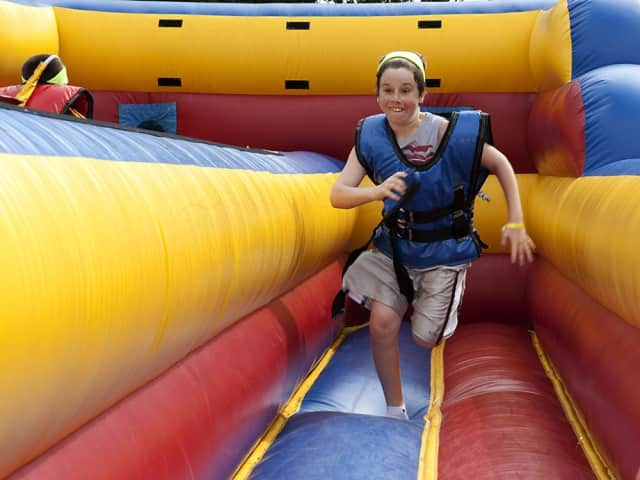A happy guest bounces around on an inflatable during Little Ferry's 2012 Family Fun Day.