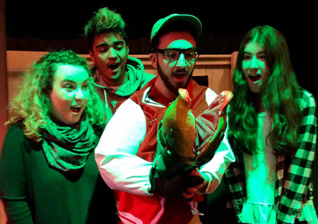 """Glen Rock High School performers set the stage for their own production of """"Little Shop of Horrors"""" in February at the school."""