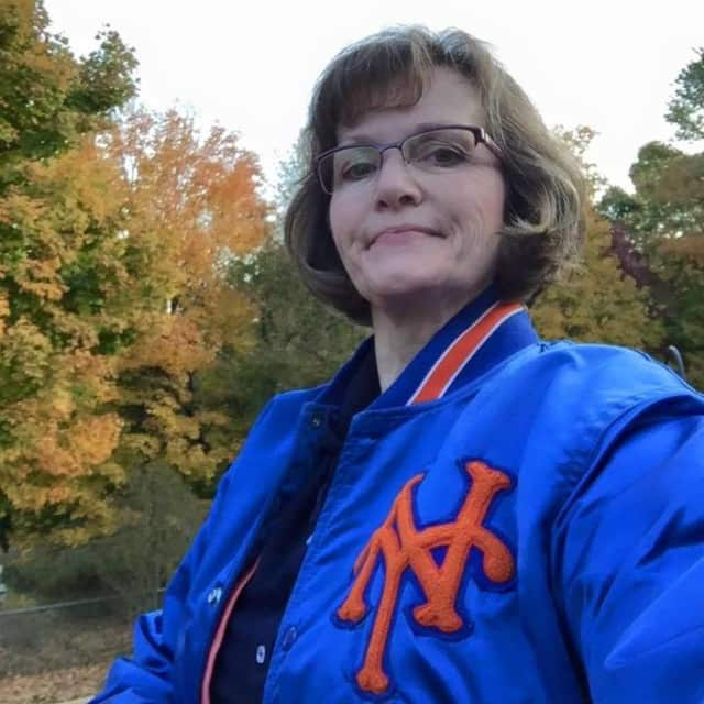 Elizabeth Healy of Danbury sports her Mets jacket with pride. The Mets face off against the Kansas City Royals on Tuesday night in the World Series opener.