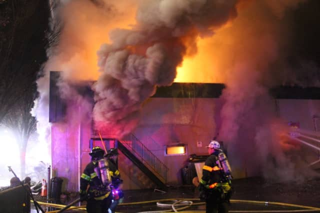 Flames shot through the roof of the uniform supply store on Main Street in Lodi.