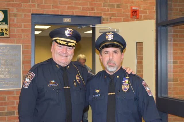 "A Jan. 18 ceremony was held to promote Chief James ""Jay"" Purcell and Major John Puglisi of the Brookfield Police Department."