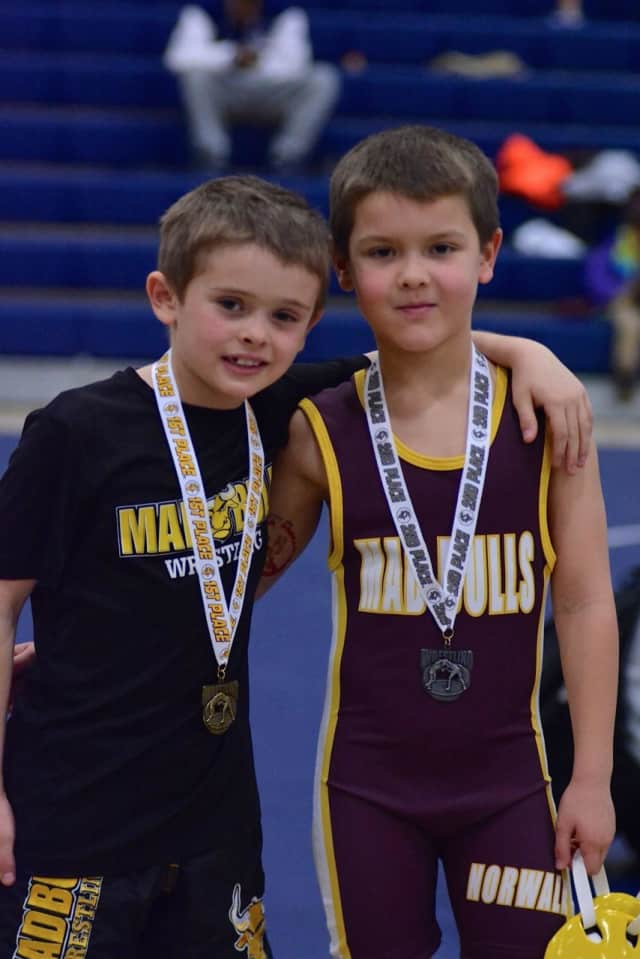 Second grade Mad Bull Grapplers Will Motley and Colin Falla both medaling in the Wilton tournament after meeting each other in the finals.