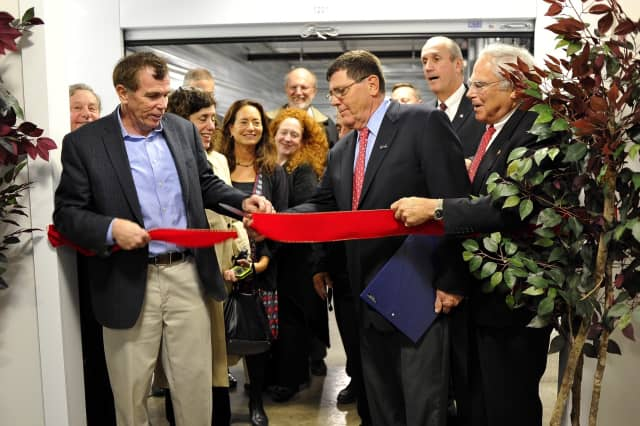 Sean and Chris Murphy along with area officials, share in the ribbon-cutting to open Mamaroneck Self Storage.