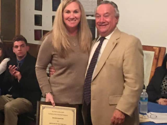 Michele Marona, senior office assistant in the Guidance Department at Ossning HighSchool, and George Weeks of the Rotary Club.