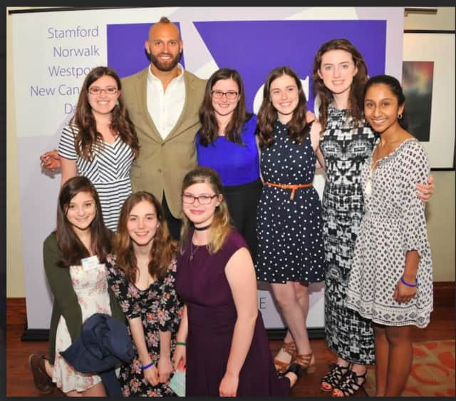 Wilton High School Teen PeaceWorks Club members with New York Giants linebacker Mark Herzlich at the Domestic Violence Crisis Center's 14th Annual Voices of Courage Spring Luncheon in May.