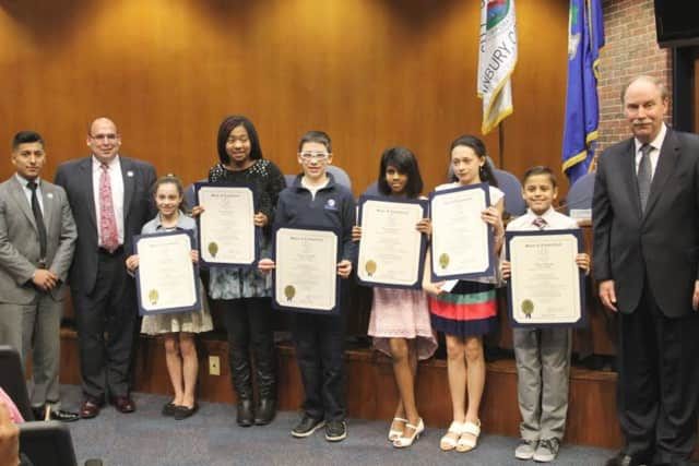 State Sen. Michael McLachlan is shown with the winners, from left, Stephen Siguenza and Vincent DiGilio, of Union Savings Bank, and students, Alyssa Ferrucci, Bianca Champion, Joseph Falcao, Amisha Malkani, Jacqueline Malanga, and Pedro Reis.