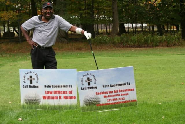A golfer at last year's Meals With a Mission charity golf outing.