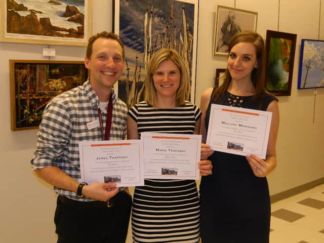 James and Marie Trapasso and Mallory Marinaro received employment milestone certificates at the Ossining Public Library's annual meeting.
