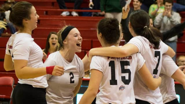 Fairfield University's Megan Theiller (2) celebrates with teammates as the Stags won the the Metro Atlantic Athletic Conference vollyeball championship.