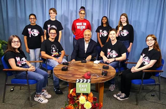 (from left, seated) Inna Trygubchuk, Eric Kopp, host Larry Lifrieri, History Club Coach Steven Muench and Rebecca Brandon; (from left, standing) Simran Singh, Tommy Tedesco, Mary Bisharah, Manasa Karthikeyan and Jamie Carenza
