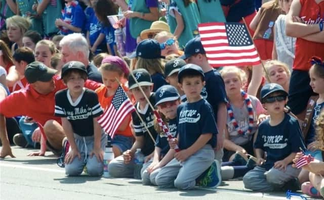 Little Leaguers watch the Memorial Day parade in Fairfield last year.
