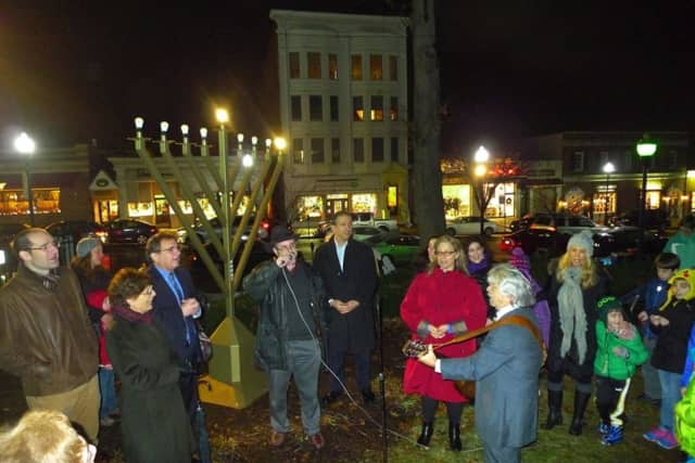 There was singing and guitar playing at last year's Menorah Lighting in Ridgewood. This year's event starts at 5:30 p.m. on Sunday, Dec. 6.
