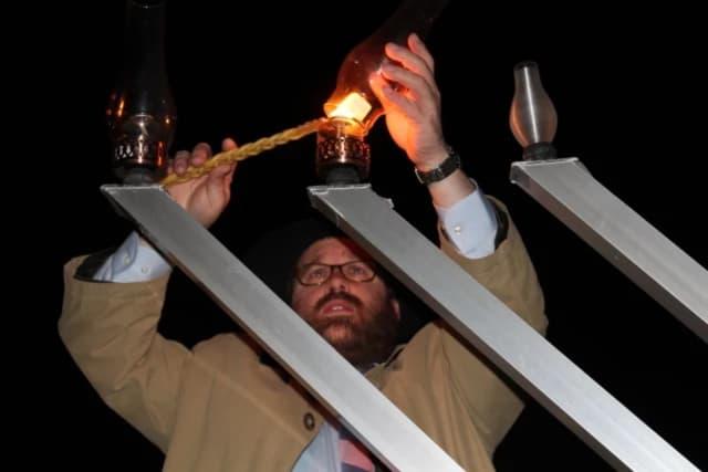 Rabbi Levi Stone lights the menorah at a 2014 Westport celebration.
