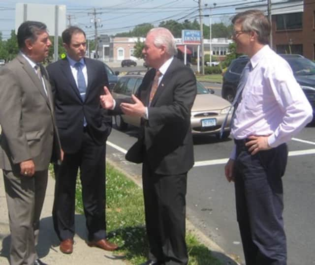 MetroCOG's Deputy Directors Mike Pavia and Patrick Carleton, First Selectman Mike Tetreau and Community and Economic Development Director Mark Barnhart standing along Black Rock Turnpike.