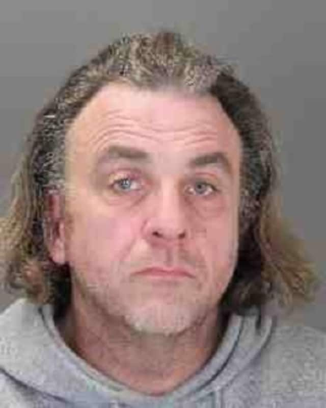 Michael Russo, 54, was arrested in Suffern Sunday in connection with the Jan. 1 burglary of an office on Route 59 in the village of Airmont, police said.