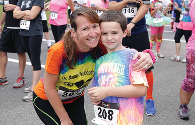 This mother and son enjoyed the festivities of the first Autism SpectRun, the Kennedy Center 5K Fun Run/Walk/Stroll. This annual event serves as a major benefit for The Kennedy Center's Autism Project.