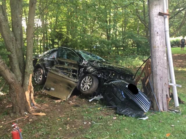 A car crashed into a pole on Cross Hill Road in Monroe on Friday morning.