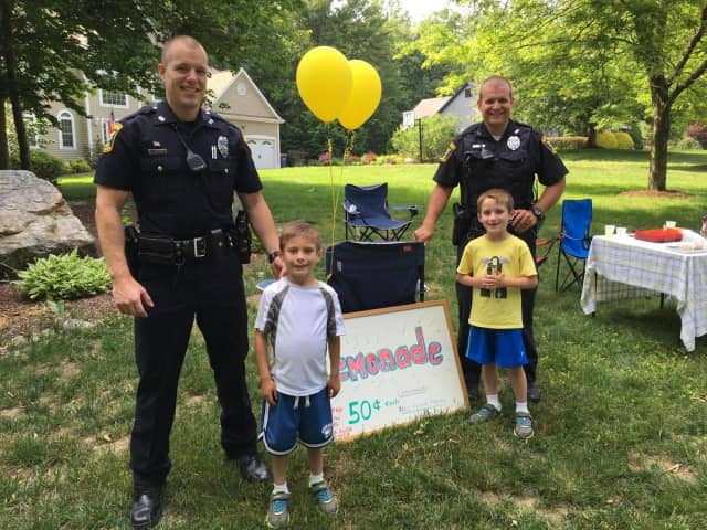 These Monroe police officers stopped by this lemonade stand in Monroe.