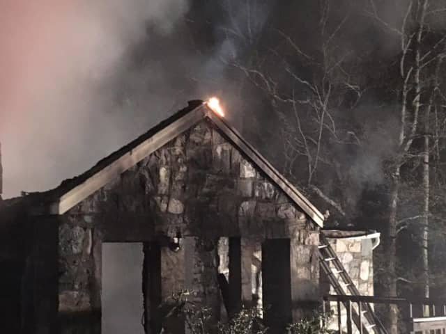 A fire gutted a Monroe home that was being renovated.