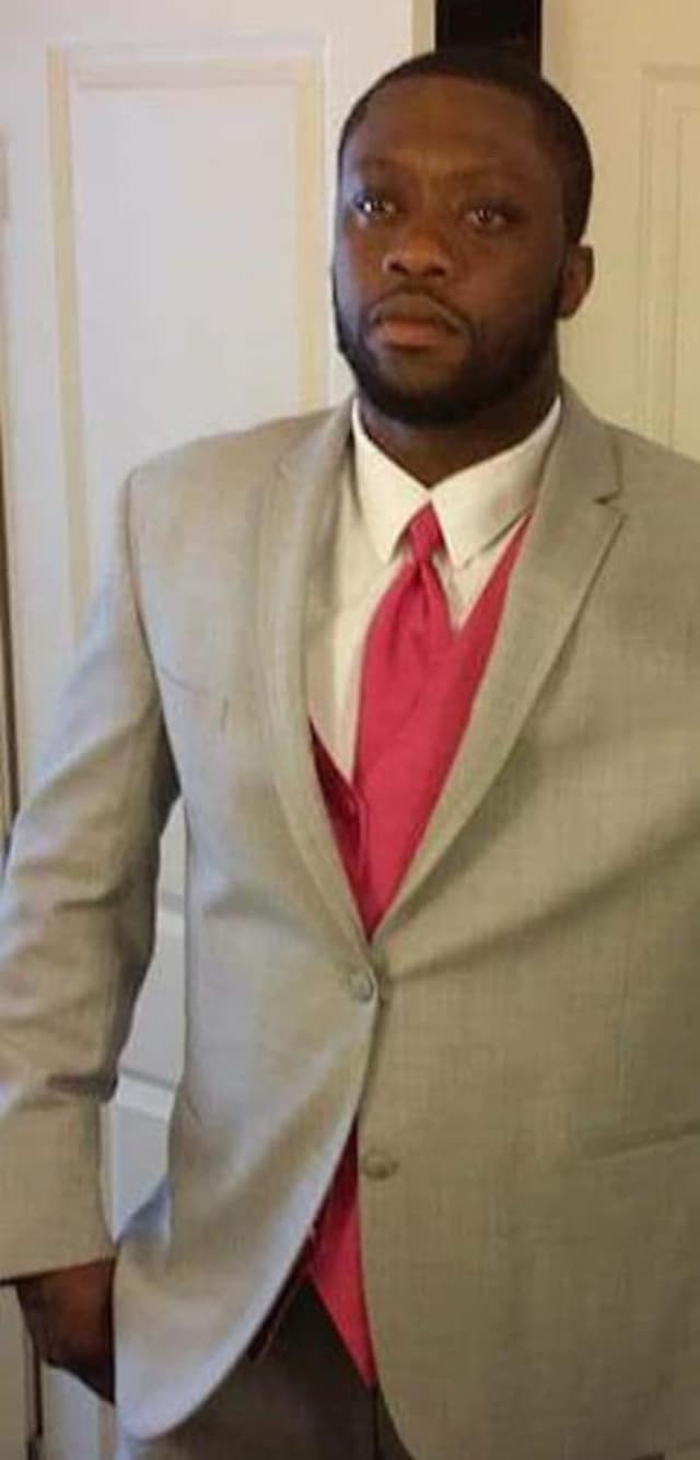 Cadell Moore, 34, of Bridgeport was shot to death while working on his car Thursday morning.