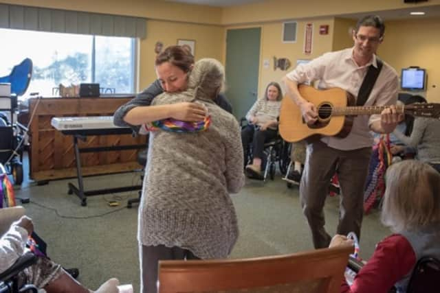 Michael LaHue, a music therapist at United Hebrew of New Rochelle, right, says music is not only soothing, it helps residents connect with themselves, their memories, and their families.