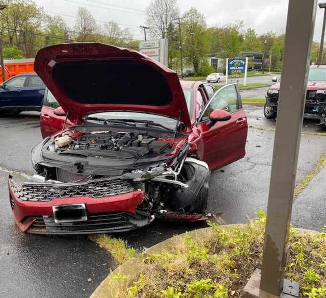A Jeep sitting in a Fairfield County car dealership parking lot was damaged when it was hit by a vehicle involved in a two-car crash.