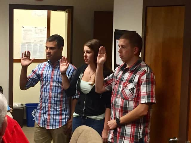New members, from left, Jacob Leff, Alexa Barlow, and Riley Mawn, are sworn in to Somers Volunteer Fire Department.