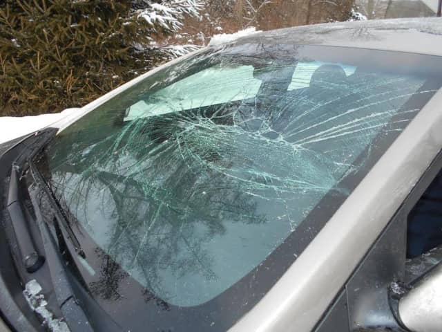 This car's windshield was smashed in Newtown when ice and snow flew off another car.