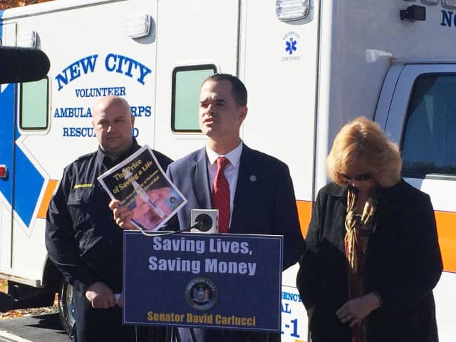 State Sen. David Carlucci speaks about price gouging for anti-opioid drugs recently. At left is Ossining Volunteer Ambulance Corps chief Nick Franzoso. Ruth Bowles, head of the Rockland Council on Alcoholism and Other Drug Depdendence is at right