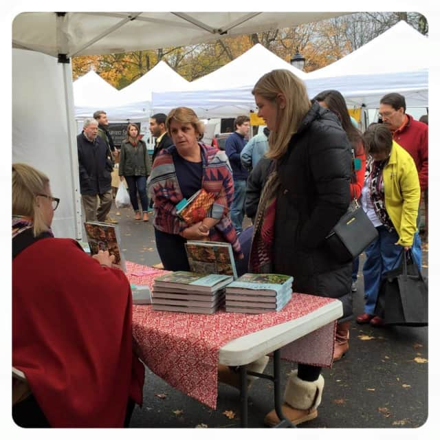 Hudson Valley resident Nancy Fuller signing her latest cookbooks at a recent special event at Rhinebeck Farmers Market.