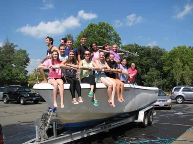 The New Canaan High School Theatre held a car wash on Saturday to raise funds that will help offset costs of the upcoming season.
