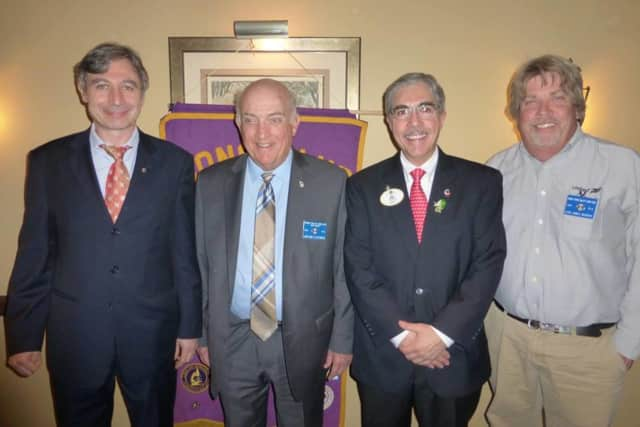 The Saddle River Valley Lions Club donated to the Upper Saddle River Fire Department at its recent dinner. (from December 2015, left to right) members Anatoly Burman and Gene Leporiere, District Governor Jack Romano, and President Jim Murphy