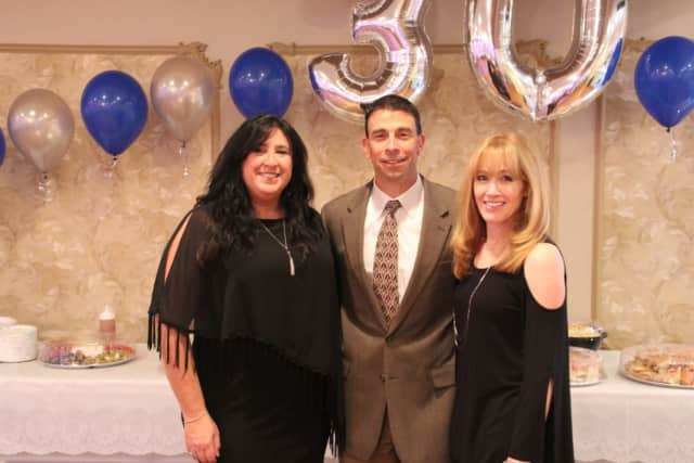 Michael Cocilovo of New City Chiropractic Center celebrated his office's 30th anniversary. From left is Office Manager Darlene Adams and Risa B. Hoag, Publicist.