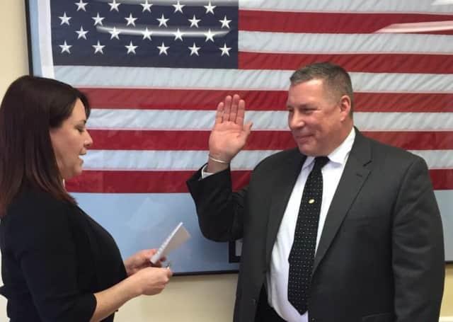 New Fairfield First Selectman Susan Chapman swears in New Fairfield Police Officer Matt Satkowski