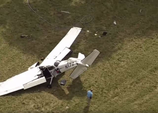 A plane crashed near the Candlelight Farms Airport in New Milford on Aug. 11. It had taken off early from Danbury Municipal Airport. Aerial photo courtesy of NBC Connecticut.