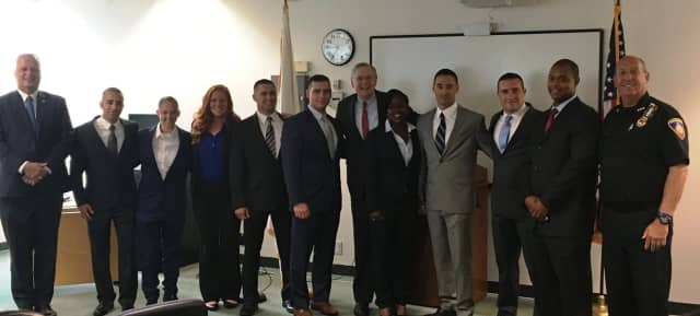 The nine new recruits to the Stamford Police Department with Mayor David Martin