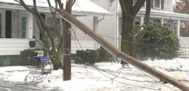 A bus crashed through a utility pole on Main Street in Garnerville, causing power outages and the street to close.