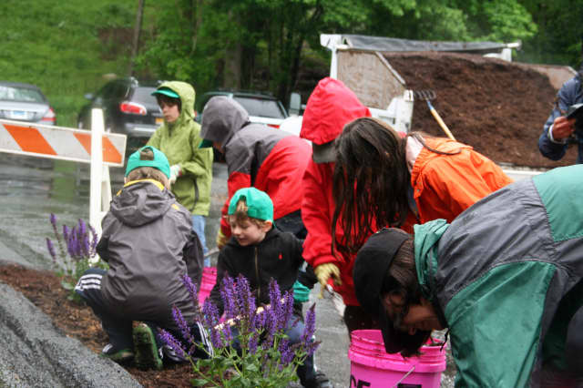 More than 100 volunteers showed up to beautify Pound Ridge on Pride Day.