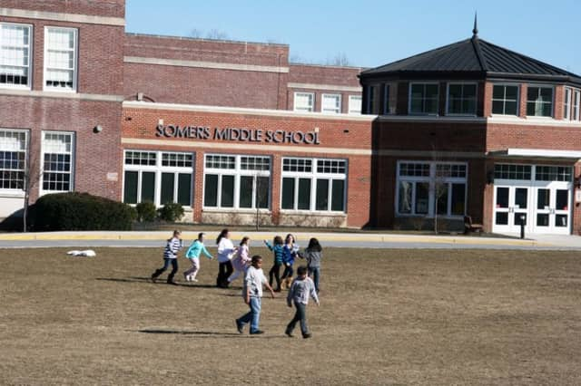 Somers Middle School, pictured, is among those whose classes were canceled on Monday due to a vandalism affecting nearly half of the school-bus fleet.