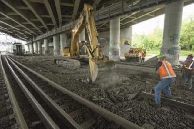 Construction crews have replaced one of the two tracks damaged in Friday's accident on the Fairfield-Bridgeport border. The second is expected to be finished Tuesday night.